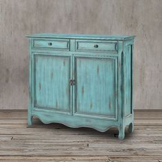 You can effortlessly add elegance to any room in your home with this beautiful weathered dark blue top-drawer cabinet made from solid wood and MDF. It features a classic weathered look,fashionable style and functional space solution.