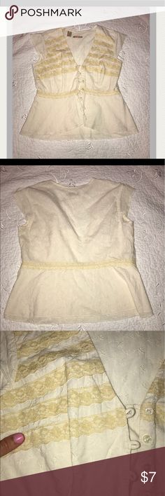 Cream colored button down blouse with lace detail Really pretty lace detail and very unique shirt!  I purchased it at Dillard's years ago and have been hoping to fit in to it again but unfortunately it is too tight on. I would love to find a good home for this shirt!  It's in great condition as well. Tops Blouses