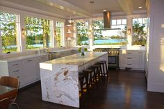 WOW! This Thermador Kitchen is beautiful! Love the windows. When placing a hood in front of a window you must order an island hood. Via thermador on facebook.