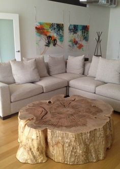 Organic wood stump coffee table by Vanillawood. table, wood edge Great Natural solution for a Coffee Table. Would hate to try and move it for cleaning.