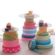 Spools of ribbon with tray / small platter / plate sitting on top!