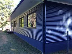 "TIP: ""Using Colorbond steel to clad our house transformed our fibro box into a beautiful home and we did all of the work ourselves. House Cladding, Exterior Cladding, House Siding, Home Remodeling Diy, Home Renovation, Steel Framing, Clad Home, Tin House, Metal Buildings"