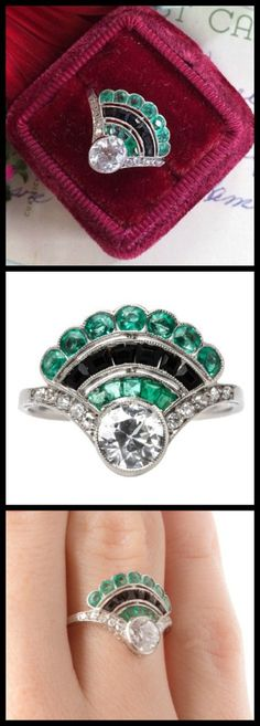 Beautiful Art Deco fan ring with emeralds, onyx, and diamonds; centered by a  0.64ct Old European diamond.
