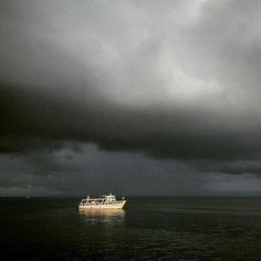 """#Emerging #Takeover @philmoorephoto: """"A #boat comes in towards port off the shore of Goma on Lake Kivu in eastern #Congo. Early morning light creeping through the mounting #storm. There will be a lot of #rain on this crossing."""" by annenbergspace"""