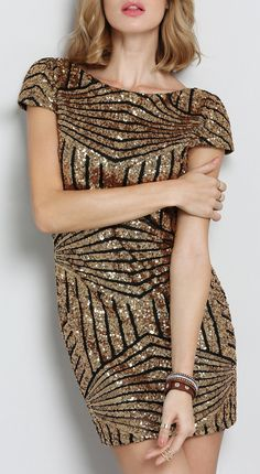 Hard not to feel absolutely stunning in this gold cap sleeve backless sequined dress.