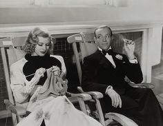 """Ginger Roger's character Linda Keene, knits as Fred Astaire looks on in 'Shall We Dance,"""" 1937."""