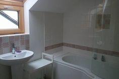 Large bathroom with shower bath