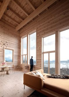 Rever & Drage Architects builds modern log cabin in Norway.