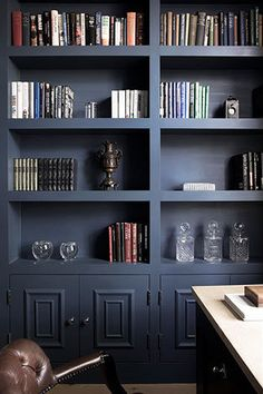 dark blue built in bookcases - love the chunky shelves...what a great way to spice up the boring white build ins we keep seeing
