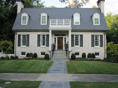 Painted Brick Houses With Wood Doors, light grey with white windows and dark grey shutters
