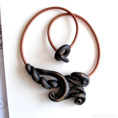 Wood and leather https://www.majzner.eu/en/home/1405-necklace-1456.html