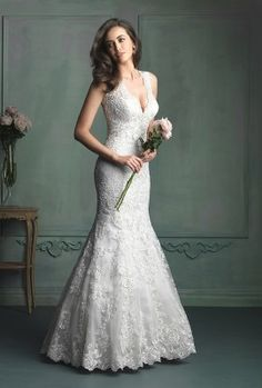 Allure Bridals 9104 - This lace bridal gown features contour straps and gorgeous Swarovski crystal beading at the neckline.