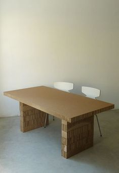 cardboard dining-table  http://www.improvisedlife.com/wp-content/uploads/2012/11/cardboard-table.jpg