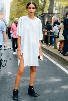 Dark lip, white t shirt dress and black sneakers. A+ Berlin style! Be inspired by more Berlin styles on AMAZE: http://on.amz.az/1IK8LkT