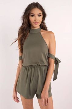 Spend the warmer days in the Sun-kissed Halter Romper. Featuring a halter neckline and arm ties. Pair with booties and a sun tan. #shoptobi