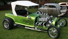 Wild proportions, iridescent green paint with lace flames, chrome plating throughout and an exposed Ford V8 engine make Vandal an interesting hot rod from the past.