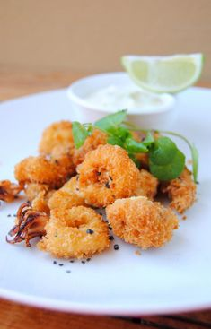 Scrumptious: Panko-Crumbed Calamari with Black Salt & White Pepper, and Lime Mayonnaise Seafood Dishes, Fish And Seafood, Seafood Recipes, Calamari Recipes, Fish Bites, Panko Crumbs, Fruit, Yummy Food, Tasty Snacks