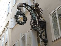 Beautiful artistic shop sign in Salzburg, Austria.