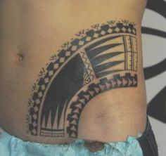Lower Male Stomach tattooed with maori combs and strips of modern polynesian symbols
