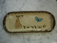 Cute dog and blue butterfly impression pottery pine needle basket bases on Etsy, $16.00