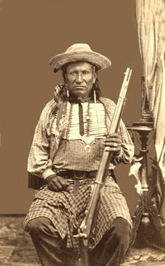 Photo: 1872-75. The subject of this photograph is most likely a Tonkawa Indian scout serving with the U.S. Army at Fort Concho. The scout is equipped with a U.S. Army Springfield rifle, and he wears a regulation U.S. Army belt with rectangular belt-plate showing the Federal eagle. The short hair-pipe breastplate is typical of those worn by Southern Plains Indians. Source: Lawrence T. Jones III.