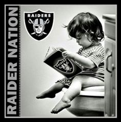Raiders little fan....just going over the play book guys......