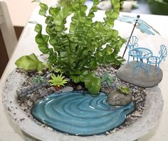 """Gotta figure out how to make this fake """"pond"""" for my fairy garden. Maybe it's that fake water that hardens after you pour it into artificial flower arrangements."""