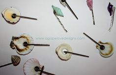 Cute shell bobby pins. Just need to find the kind with that extra circular pad for glueing.