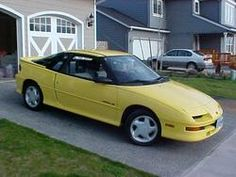 Yellow Geo Storm-my old car.  Oh, how I miss you.