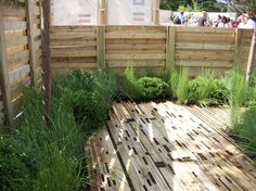 Pallet fence and decking. Use scaffolding boards instead of pallets for decking as they're a lot more durable.