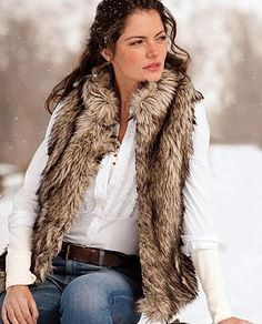 Google Image Result for http://www.glamour.com/fashion/blogs/slaves-to-fashion/2010/10/18/1018eddie-bauer-faux-fur-vest_fa.jpg