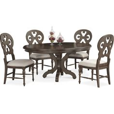 Intimate Family Gatherings. Channel the serenity of a quaint cottage with the Charleston round dining set. Each piece is expertly crafted to feature rich details, which include a gray, vintage finish and traditional moldings. An elegant, scalloped pedestal base and scroll-back chair design add exquisite finishing touches, providing you with a well-furnished dining room. Customer assembly required.
