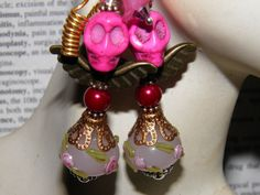 Day of the Dead Angel Earrings Handcrafted with Pink Sugar Skulls, Copper Angel Wings, Handmade Artisan Lampwork Glass Beads, Burgundy Pearls, and Pink Frosted Lucite Flowers. One of a Kind Original Jewelry by MelancholyMind, $14.99