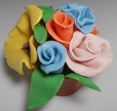 I haven't made melt and pour soap for a while, so I thought I would try sculpting some flowers. For every square of MP soap (0.8 oz), I ad...