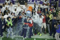 New England Patriots head coach Bill Belichick is dunked with water on the sidelines during the second half of NFL Super Bowl XLIX football game against the Seattle Seahawks Sunday, Feb. 1, 2015, in Glendale, Ariz. The Patriots won 28-24.