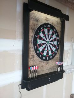 Dart Board Cabinet Dart Board Backboard LED Lighted Laser Throw line Auto ON/OFF OVERVIEW: Approximately x x Solid Cedar dart cabinet Stained with ebony color indoor wood stain Garage Game Rooms, Game Room Basement, Diy Home Bar, Bars For Home, Dart Board Backboard, Pool Table Room, Game Room Design, Man Cave Home Bar, Billiard Room