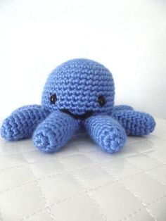 I can be made in any color you would like. My eyes are made with black thread so I have no small parts for children. Cuddly and soft, I come from a smoke free home and am pre washed with baby detergent so I am clean and ready to go. I am 5 inches tall and about 12 inches from tentacle to tentacle. I also come with a cute surprise.
