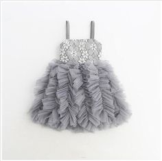 We are obsessed with all of the amazing details on this dress. A full tiered tulle skirt- beautiful lace bodice- and white flower details- this dress has Pastel Grey, Trendy Girl, Lace Bodice, Shades Of Grey, White Flowers, Tutu, What To Wear, Floral, Beautiful