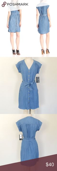 Sangria blue denim shirt dress Retail price $69 plus tax. New with tags. Very simple yet elegant blue denim shirt dress from Sangria. Perfect for casual daily wear and vacations. Short sleeves. Button front closures. Denim tie belt in same color. Can be tied at front or back. Modern shirt dress silhouette.  60% Tencel Lyocell, 40% Rayon. Size 4:  Bust 33.5-34, Waist 25.5-26, Hips 36-36.5 Sangria Dresses Mini