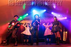 Steam Powered Giraffe on stage at The Steampunk World's Fair. Hatchworth, The Spine, Rabbit, and Walter Girls Carolina  Chelsea. You can find this and many more official SPG prints in the GeekShot store.