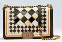 Beige, gold, & black Chanel bag