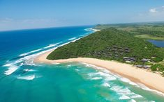 South Africans cross the border just to bask on these secluded beaches, whose glittering turquoise waters are shielded by miles of dry savanna, swampy forest, and floodplains of reed beds and papyrus. Pearl Beach Resort, Mozambique Beaches, Travel Chic, Secluded Beach, New Africa, Best Resorts, Paragliding, Turquoise Water, Africa Travel