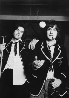 The Kinks, Ray Davies and Dave Davies, dressed in school uniform to promote the album 'Schoolboys In Disgrace', London, January 1976. (Photo by Michael Putland)
