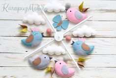"((( INCLUDES ))) This nursery mobile contains 4 birds, 4 clouds and 2 butterflies.They are suspended from an ivory wood hanger, about 13' x 13"".  This item made by hand - no machines involved...."