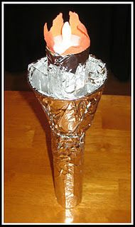 Make Lady Liberty's Torch out of a paper towel roll, disposable cup, foil, construction paper, toothpicks and a flameless tealight!