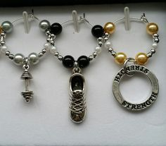 This is the latest design! There are 6 unique charms representing something to do with being fit. You could use these for yourself or gift someone you know loves to be fit! These charms have been made each with tiny silver beads, white beads and each has a different accent glass pearl bead. These wine charms will look great when you make your toasts. These charms could also be used on mugs or anything else you want to keep identified. These charms are made from a zinc alloy metal which is...