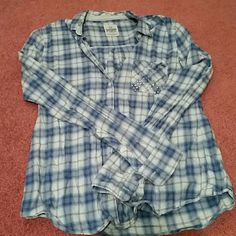 Victoria's secret button down rhinestone shirt This shirt is so adorable. The rhinestone pocket adds bling to what would be a normal plaid top. Perfect paired with Jean shorts in the summer or jeans and boots for the fall. Like new condition Victoria's Secret Tops Button Down Shirts