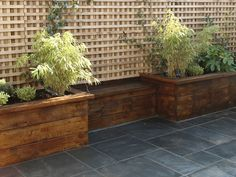 slate tiling with wood raised beds