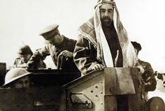 Lot 11588-12: Activities in the Middle East. Australians in Syria. The Emir Abdulla of Transjordan, riding in an Australian Bren Gun carrier at a review of Australian troops near Jericho. Office of War Information Photograph.