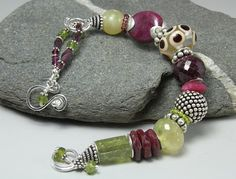 Kay Rashka. Ruby Wrist Candy Bracelet.  Took a class from her in 2010, river stone earrings.  She is a fabulous artist!